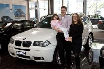 Australian X3 sales reach 6,000 milestone: Andrew and Branca McFarlane and daughter Sienna (copyright image)