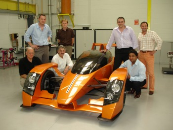 (l to r front row) David Skertchly, Gordon Murray, Angad Paul; (l to r back row)  Ben Scott-Geddes, Stephen Irish, Graham Halstead and Sean Butcher. Caparo's  elite group of vehicle design engineers has a high level of aluminium, steel and  composite materials expertise and the ability to design components, systems and  the whole vehicle. Pictured with Caparo T1 prototype at Caparo Vehicle  Technologies new factory at Basingstoke.