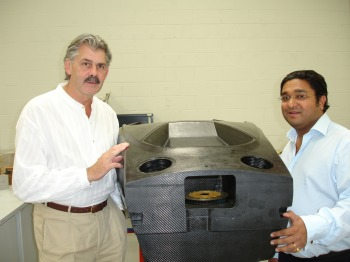 Gordon Murray (left)  advanced concepts director Caparo Vehicle Products joins Caparo group chairman  Angad Paul in his company's ambition to make modern composite materials more  widely available to carmakers and hence make lightweight low CO<SUB>2</SUB> cars  a reality. Pictured with Caparo T1 composite tub.
