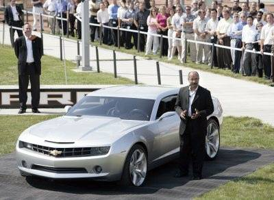 GM Vice President Global Design Ed Welburn stands with the Camaro concept
