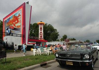 A classic Ford parades past the Mustang Drive-In during the 2002 Woodward Dream 