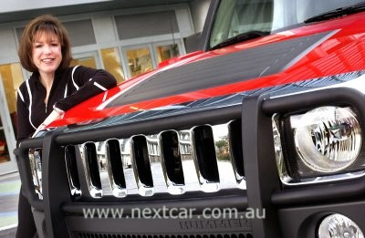 Susan Docherty with the Hummer H3