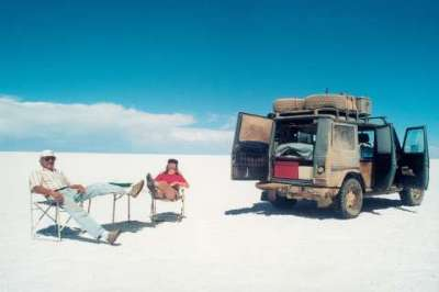 The Holtorfs relax on the world's largest saltpan in Bolivia with their Mercedes-Benz G-Class