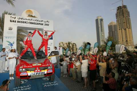 Mitsubishi Motors Repsol Team driver  Stéphane Peterhansel and co-driver  Jean-Paul Cottret clinched their  third UAE Desert Challenge  victory in four years