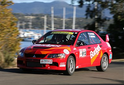 Peter Brown and Nicole Locker  driving the Mitsubishi Lancer  Evolution IX to showroom car  class success in Targa Tasmania
