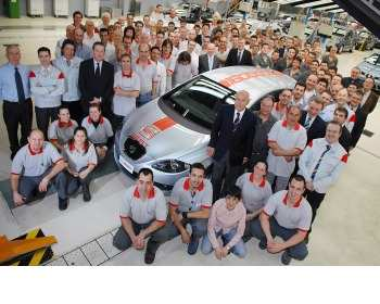 SEAT President Erich Schmitt with the firm's 16 millionth vehicle: a Leon Ecomotive
