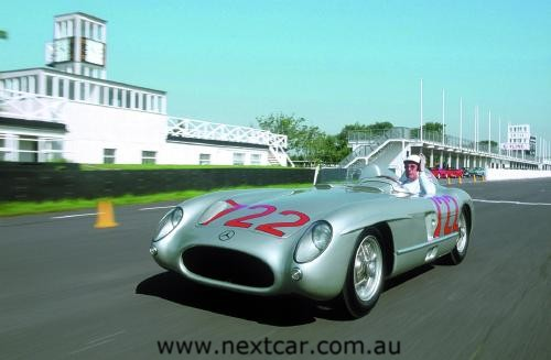 Sir Stirling Moss  behind the wheel of the historic Mercedes-Benz 300 SLR