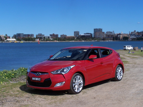 www.nextcar.com.au (copyright image) - Hyundai Veloster finished in Veloster Red - 2012 - Australia