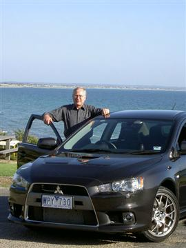 Stephen Walker with the Mitsubishi Lancer Evolution MR (copyright image)