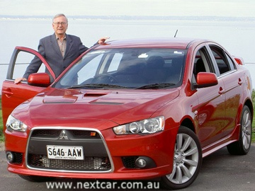 Stephen Walker with the  Mitsubishi Lancer Ralliart road test car (copyright image)